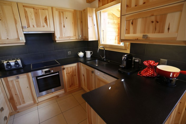 Modern fully fitted kitchen with stone workstop, nespresso machine, microwave, professional raclette machine, fondue set and plenty of other equipment for the most discerning cook.