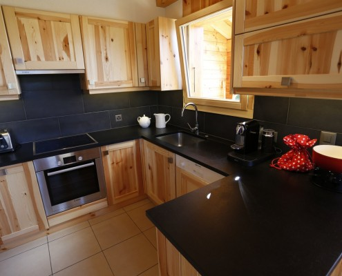 Modern fully fitted kitchen with stone workstop, nespresso machine, microwave, professional raclette machine, fondue set and plenty of other equipment for the most discerning cook